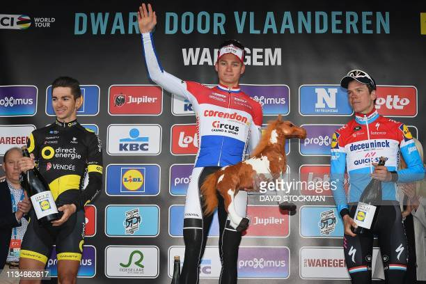 Netherlands' Matthieu Van der Poel of CorendonCircus celebrates his victory flanked by secondplaced France's Anthony Turgis of Direct Energie and...
