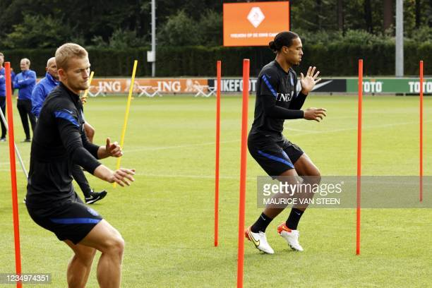 Netherlands' Matthijs de Ligt and Netherlands' Virgil van Dijk take part in a training session at the KNVB Campus as part of the preparation for the...