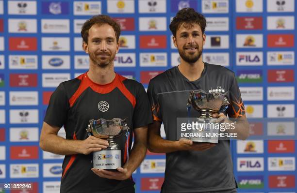 Netherlands' Matwe Middelkoop and Robin Haase pose with the trophy after winning the men's doubles of the Tata Open Maharashtra ATP tennis tournament...