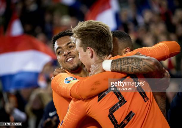 Netherlands' Memphis Depay celebrates with Donyell Malen and Frenkie de Jong after scoring a goal during the UEFA Euro 2020 group C qualifying...