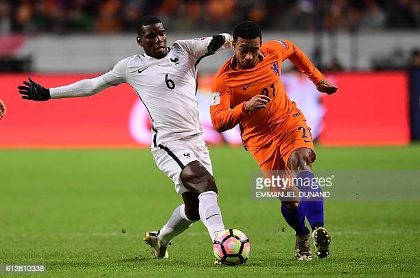 Netherlands' Memphis Depay vies with France's Paul Pogba during the FIFA World Cup 2018 qualifying football match Netherlands vs France on October 10...