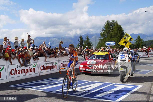 Netherlands' Michael Boogerd of the dutch Rabobank team crosses the finish line of the 16th stage of the 89th Tour de France in La Plagne 24 July 2002
