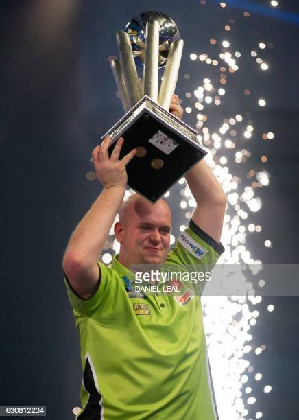 Netherlands' Michael van Gerwen celebrates with the Sid Waddell trophy after his victory in the PDC World Championship darts final over Scotland's...
