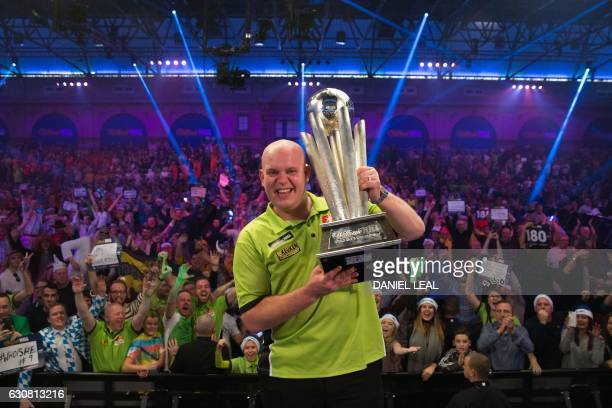 Netherlands' Michael van Gerwen poses for a photograph with the Sid Waddell trophy after his victory in the PDC World Championship darts final over...