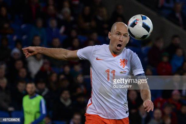 Netherlands' midfielder Arjen Robben prepares to shoot and miss during the international friendly football match between Wales and Netherlands at...