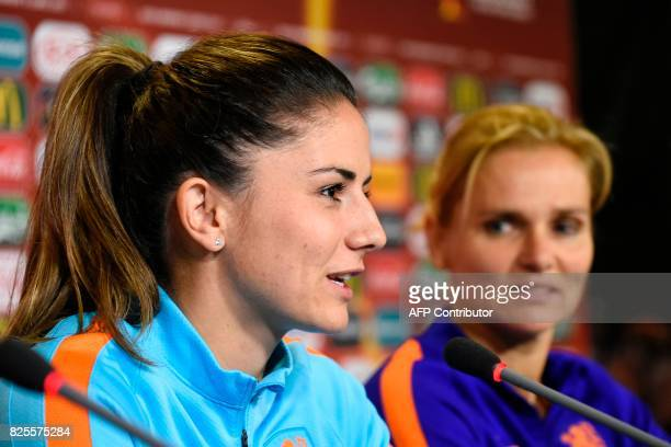 Netherlands' midfielder Danielle van de Donk and Netherlands' coach Sarina Wiegman hold a press conference in Enschede on August 2 on the eve of the...