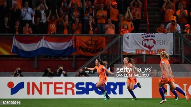 Netherlands' midfielder Danielle van de Donk celebrates after scoring a goal during the UEFA Womens Euro 2017 football tournament semi-final match...