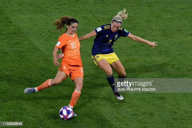 Netherlands' midfielder Danielle van de Donk vies for the ball with Sweden's defender Linda Sembrant during the France 2019 Women's World Cup...