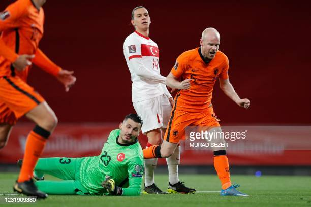 Netherlands' midfielder Davy Klaassen celebrates past Turkey's goalkeeper Ugurcan Cakir after scoring his team's first goal during the FIFA World Cup...