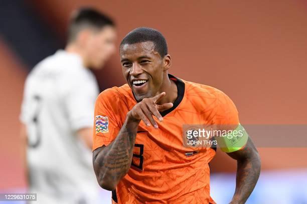 Netherlands' midfielder Georginio Wijnaldum celebrates after scoring his second goal during the UEFA Nations League football match between The...