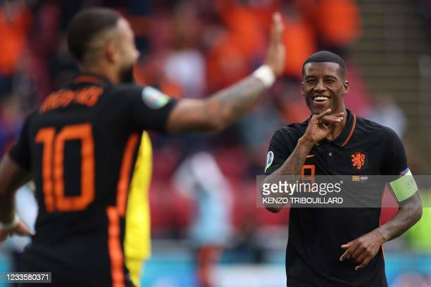 Netherlands' midfielder Georginio Wijnaldum celebrates scoring his team's second goal during the UEFA EURO 2020 Group C football match between North...