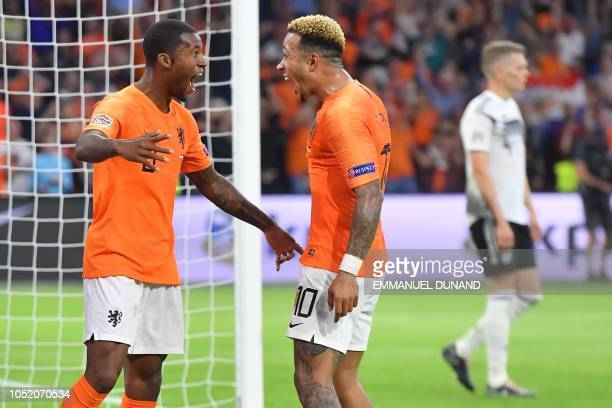 TOPSHOT Netherlands' midfielder Georginio Wijnaldum celebrates with Netherlands' forward Memphis Depay after scoring a goal during the UEFA Nations...