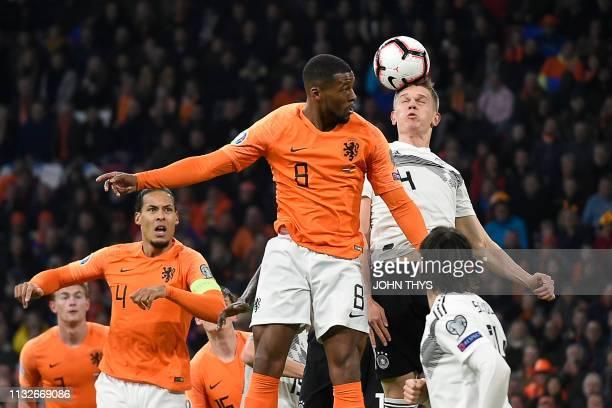 Netherlands' midfielder Georginio Wijnaldum heads the ball with Germany's defender Matthias Ginter during the UEFA Euro 2020 Group C qualification...