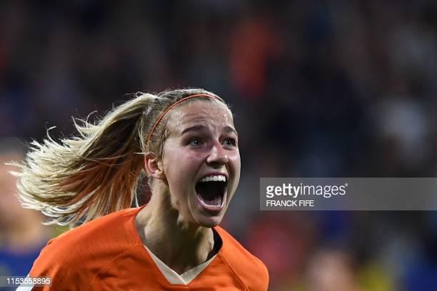 TOPSHOT Netherlands' midfielder Jackie Groenen celebrates after scoring a goal during the France 2019 Women's World Cup semifinal football match...
