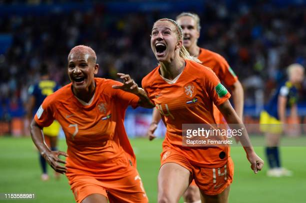 Netherland's midfielder Jackie Groenen celebrates her goal during the 2019 FIFA Women's World Cup France Semi Final match between Netherlands and...