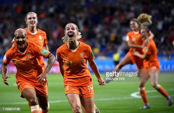 Netherlands' midfielder Jackie Groenen is congratulated by teammates after scoring a goal during the France 2019 Women's World Cup semifinal football...