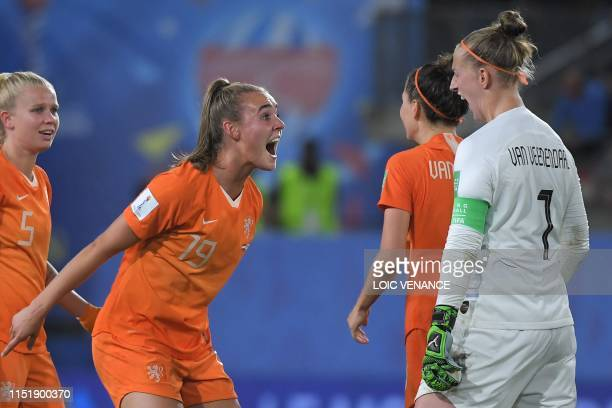 TOPSHOT Netherlands' midfielder Jill Roord and Netherlands' goalkeeper Sari van Veenendaal celebrate at the end of the France 2019 Women's World Cup...
