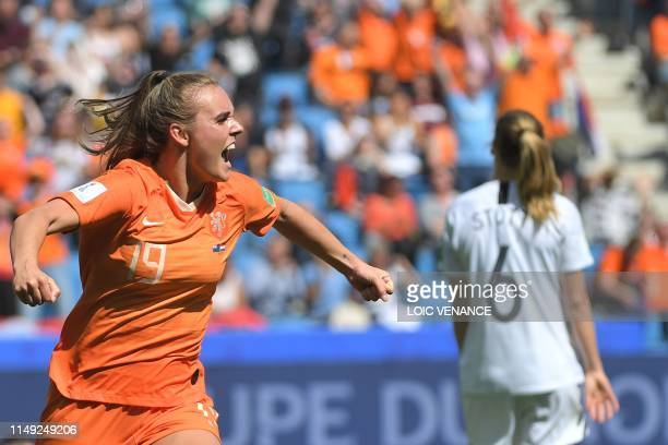 TOPSHOT Netherlands' midfielder Jill Roord celebrates after scoring a goal during the France 2019 Women's World Cup Group E football match between...