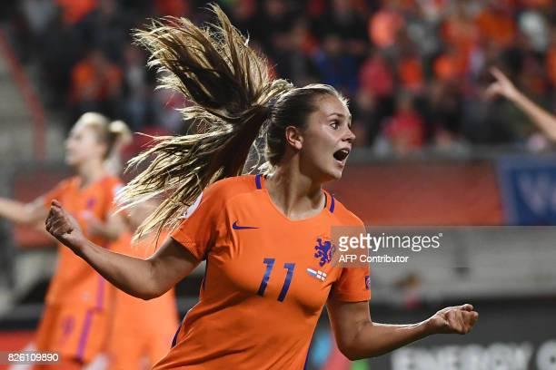 Netherlands' midfielder Lieke Martens celebrates her team's third goal during the UEFA Womens Euro 2017 football tournament semifinal match between...