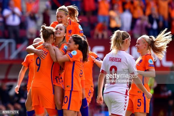 Netherlands' midfielder Lieke Martens celebrates with teammates after scoring a goal during the UEFA Womens Euro 2017 football tournament final match...