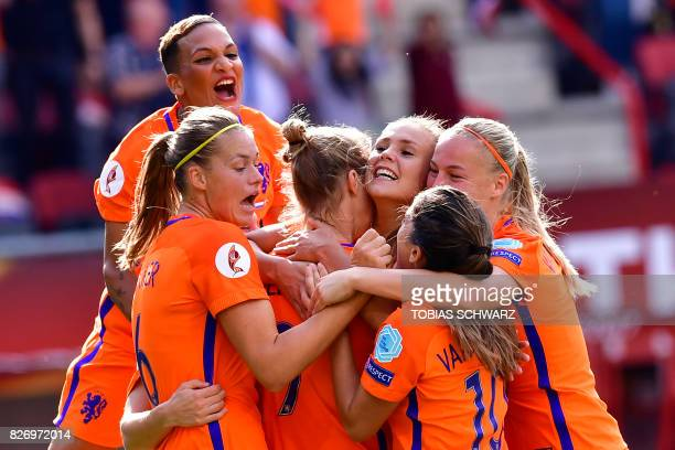 Netherlands' midfielder Lieke Martens celebrates with teammates after scoring a goal during the UEFA Womens Euro 2017 football tournament final match...