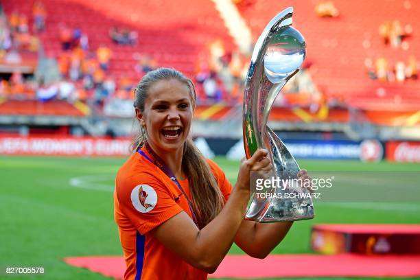 Netherlands' midfielder Lieke Martens celebrates with the trophy after winning with her team the UEFA Womens Euro 2017 football tournament final...