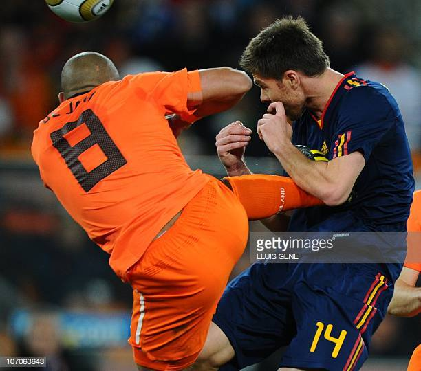 Netherlands' midfielder Nigel de Jong fouls Spain's midfielder Xabi Alonso during the ball during the 2010 World Cup football final at Soccer City...