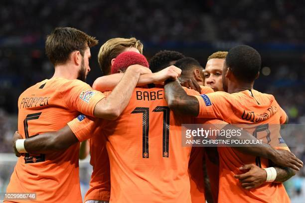 Netherlands' midfielder Ryan Babel celebrates with teammates after scoring a goal during the UEFA Nations League football match between France and...