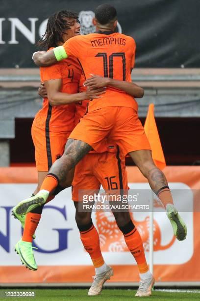 Netherlands' midfielder Ryan Gravenberch celebrates scoring his team's third goal with Netherlands' defender Nathan Ake and Netherlands' forward...