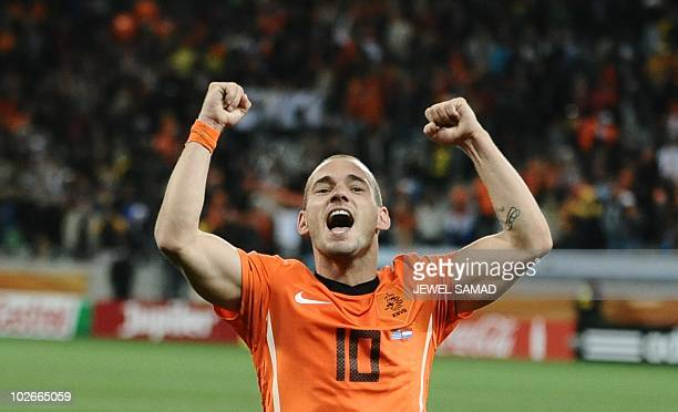 Netherlands' midfielder Wesley Sneijder celebrates at the end of the 2010 World Cup semifinal football match between Uruguay and Netherlands on July...