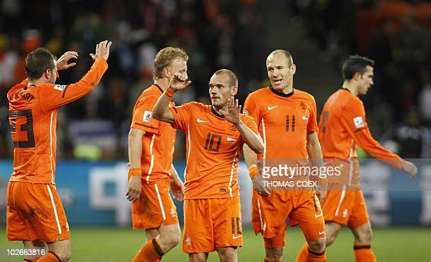 Netherlands' midfielder Wesley Sneijder celebrates with Netherlands' striker Arjen Robben after scoring a second goal during the 2010 World Cup semi...