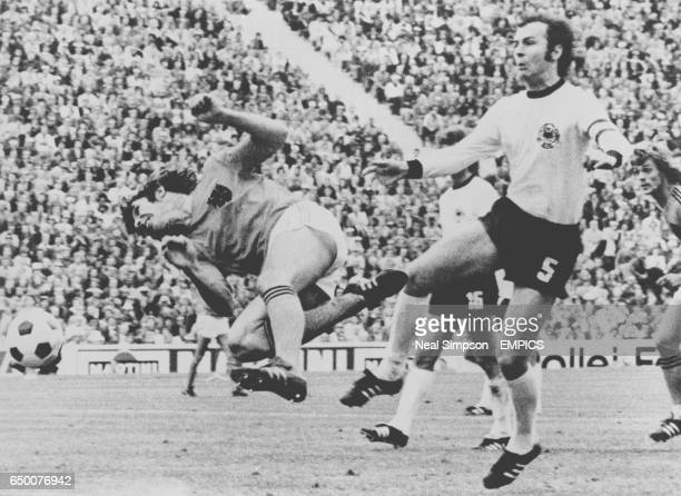 Netherlands midfielder Willem van Hanegem and West Germany captain Franz Beckenbauer in action during the FIFA World Cup Final