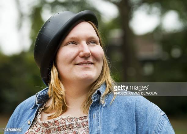 Netherlands' Mienke de Wilde a member of the Church of the Flying Spaghetti Monster movement poses with a colander on her head in Nijmegen on August...