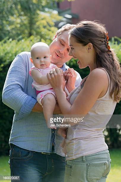 netherlands, mijnsheerenland, family with baby daughter (6-11 months) in park - mijnsheerenland stock pictures, royalty-free photos & images