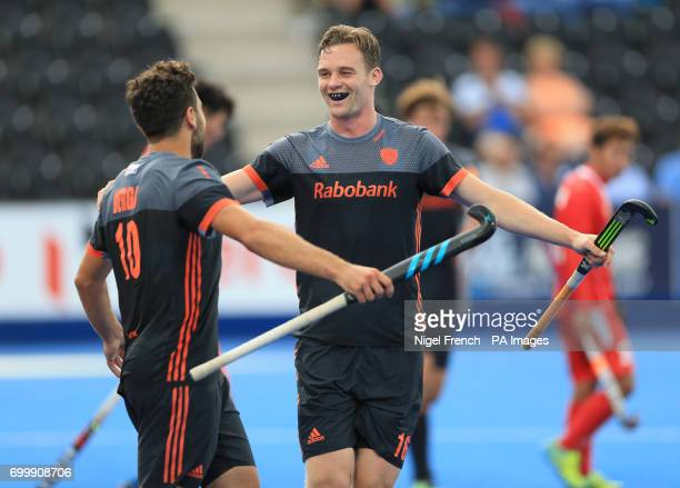 Netherlands' Mirco Pruiser celebrates scoring his side's seventh goal of the game against China with Valentin Verga during the Men's World Hockey...