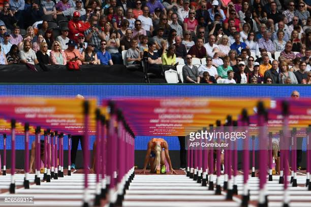 TOPSHOT Netherlands' Nadine Broersen competes in the 100m hurdles of the women's heptathlon athletics event at the 2017 IAAF World Championships at...
