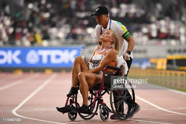 Netherlands' Nadine Broersen is wheeled off the track after the Women's 800m Heptathlon final at the 2019 IAAF Athletics World Championships at the...