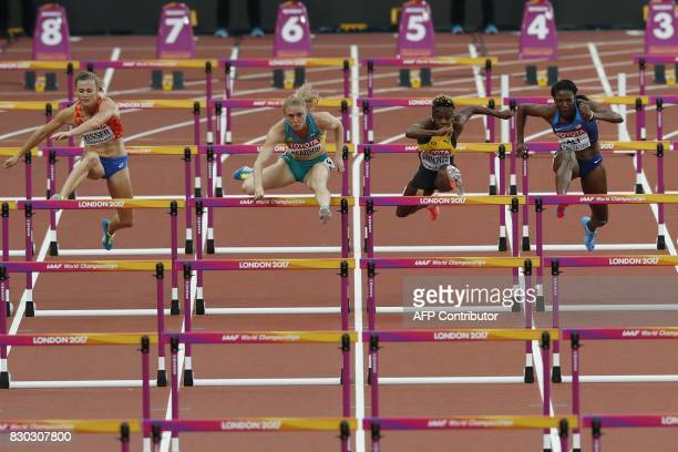 TOPSHOT Netherlands' Nadine Visser Australia's Sally Pearson Jamaica's Megan Simmonds and US athlete Nia Ali compete in the semifinal of the women's...