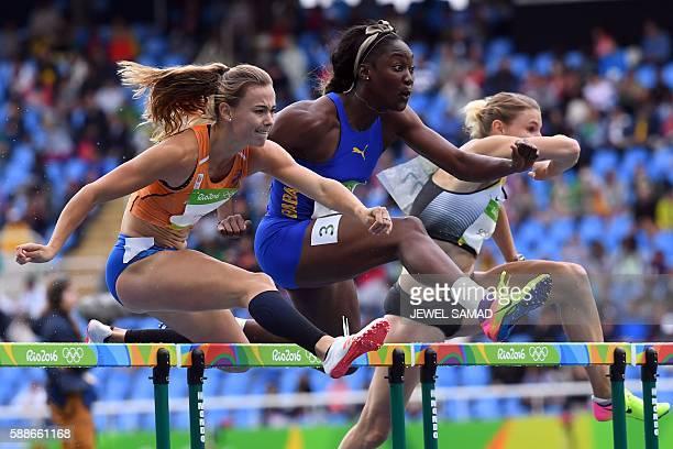 TOPSHOT Netherlands' Nadine Visser Barbados' Akela Jones and Germany's Carolin Schafer compete in the Women's Heptathlon 100m Hurdles during the...