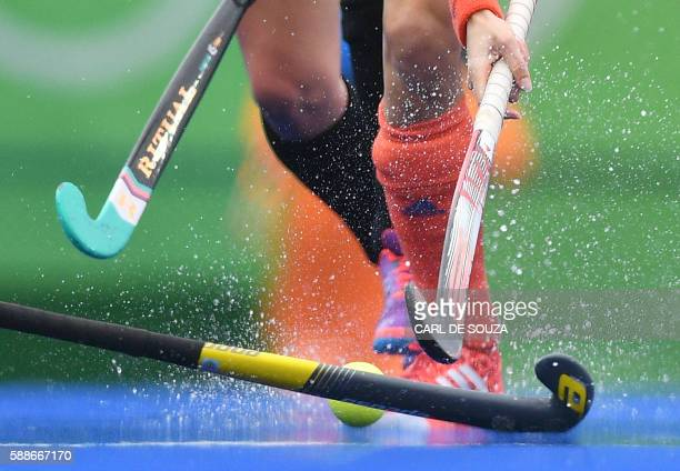 Netherlands' Naomi As van is tackled by New Zealand's Petrea Webster during the womens's field hockey New Zealand vs Netherlands match of the Rio...