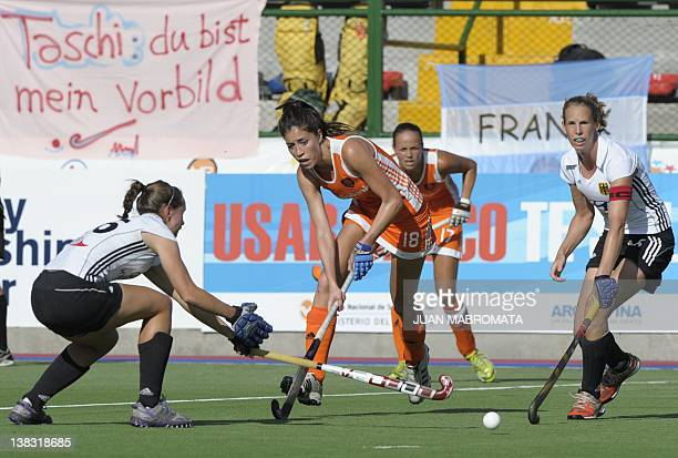 Netherlands' Naomi Van As vies for the ball with Germany's Celine Wilde and Fanny Rinne during their Champions Trophy 2012 3rd place field hockey...