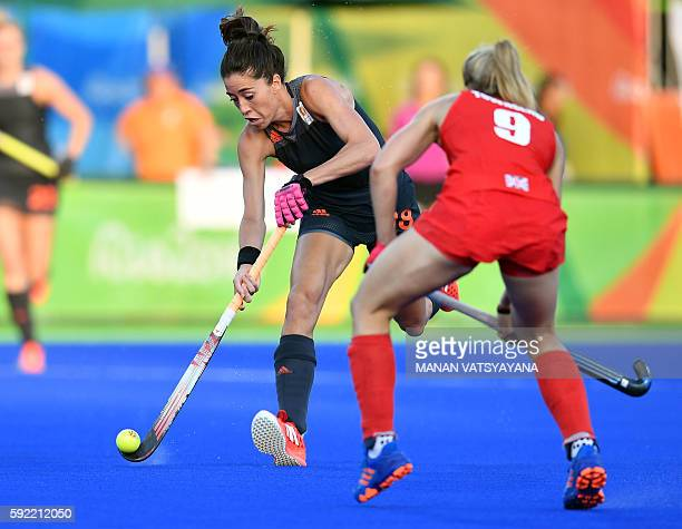 Netherlands' Naomi van As vies with Britain's Susannah Townsend during the women's Gold medal hockey Netherlands vs Britain match of the Rio 2016...