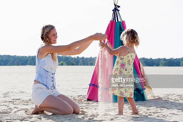 Netherlands, Nationaal Park De Loonse en Drunense Duinen, Mother playing with daughter (2-3) at sandy beach