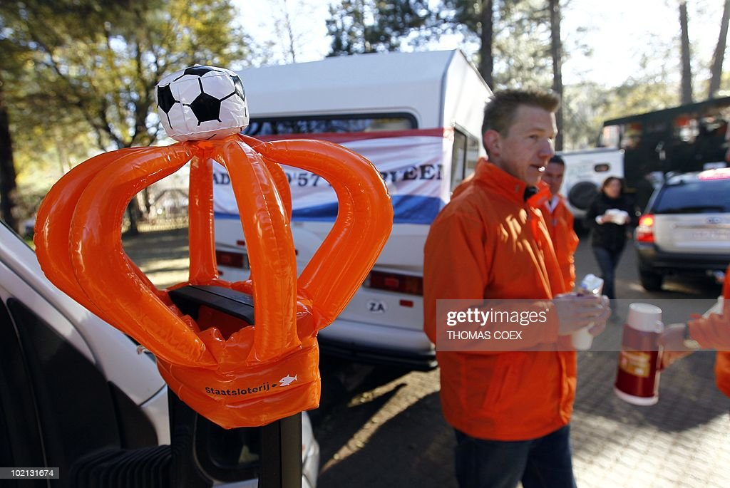 Netherlands' national football team supporters share coffee before driving in a convoy of 140 'Oranje' vehicles from the Fountainvalley camp, northern Johannesburg on June 16, 2010. Around 700 Dutch fans will move from Johannesburg to Durban, where their team will play their second 2010 Football World Cup match against Japan on June 19.