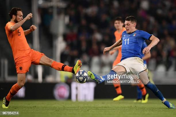 Netherlands National team defender Daley Blind fights for the ball with Italy's national team forward Andrea Belotti during the international...