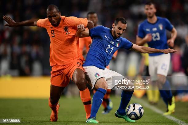 Netherlands National team forward Ryan Babel fights for the ball with Italy's national team midfielder Davide Zappacosta during the international...