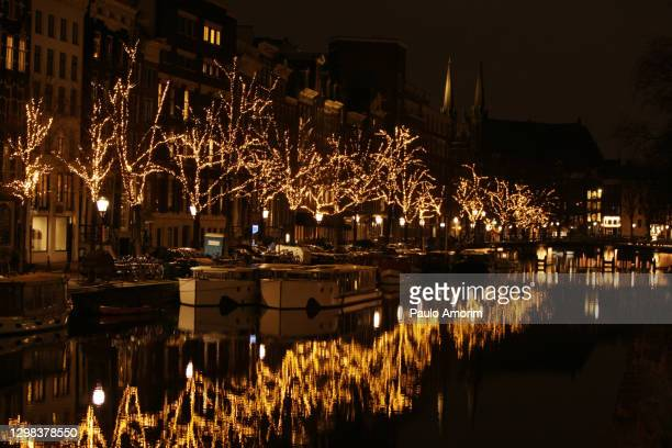 netherlands nationwide curfew amid the coronavirus pandemic in amsterdam - curfew stock pictures, royalty-free photos & images