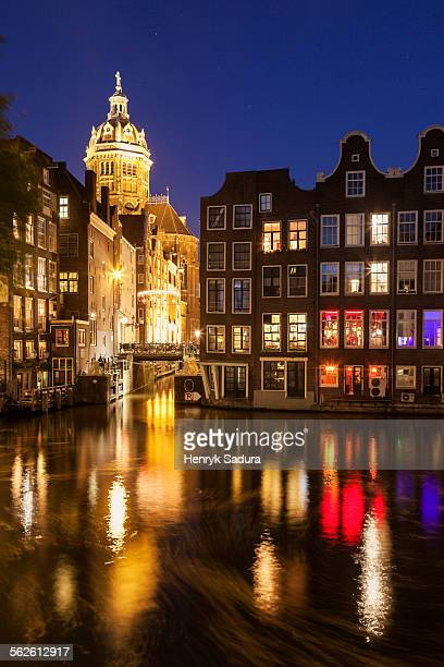 Netherlands, North Holland, Amsterdam, Illuminated buildings by canal at night