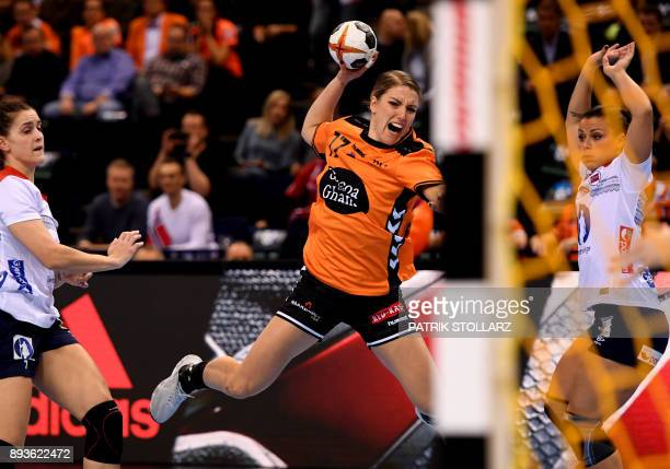 Netherlands' Nycke Groot shoots during the IHF Womens World Championship handball half-final match between Norway and Netherlands on December 15,...