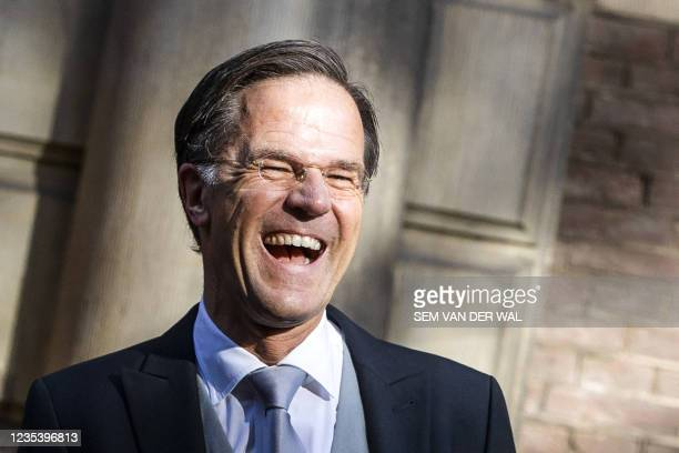 Netherlands' outgoing Prime Minister Mark Rutte laughs as he leaves the Ministry of General Affairs on Budget Day in The Hague on September 21, 2021....